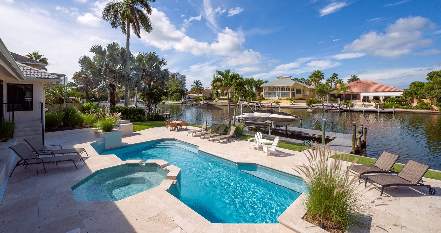 Boats and a private pool line one of Sarasota's many bay-access inlets